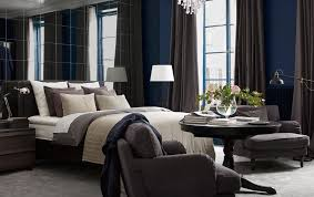 hotel style furniture. bedroom with a wall of mirrors bed lots textiles an armchair hotel style furniture e