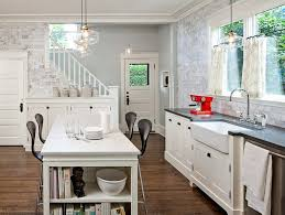 kitchen sink medium size lovely brick wall model and wooden floor and casual windows model and above sink lighting
