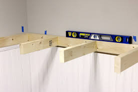 tutorial on how to build diy floating shelves via jen woodhouse build floating