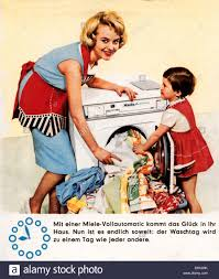 housewife cleaning 1950s stock photos housewife cleaning 1950s advertising household miele washing machine mother and child washing clothes