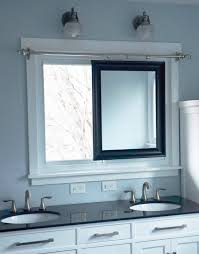 sliding bathroom mirror: master bathroom remodel with sliding mirror across window diy by since i became a