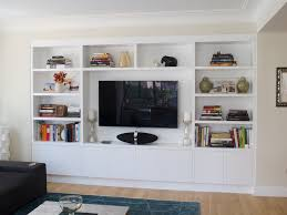 furniture living room wall: furniturecustom television built in wall units cabinet for book shelf and lcd storage as well as black vinyl sofa and rugs over wooden floors in white