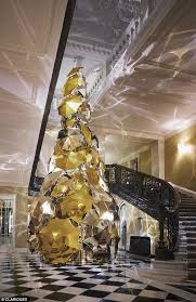metre giant umbrella: standing proudly in the art deco lobby of londons claridges burberrys extravagant six metre