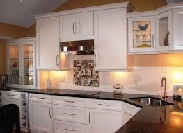 corner sinks design showcase:  compact corner sink in a kitchen with dark countertop and white cabinets