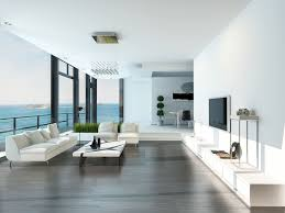 stark white and dark hardwood flooring style this open design living room illuminated naturally via beautiful white living room