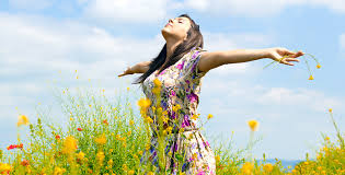 Woman in a field who has just bought life insurance