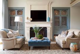 large seating arrangements can feel a bit empty if there is too much distance between the sofa and coffee table choosing a big upholstered ottoman instead big living rooms