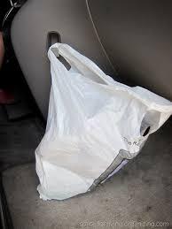 Image result for trash bag in car