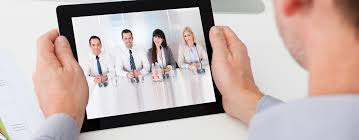 how to do a video interview the right way rezoomo blog close up of businessman looking at video conference on digital tablet