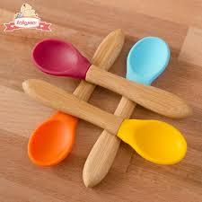 yellow painted kitchen utensils handles bamboo