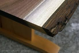 walnut cherry dining: edge  live edge walnut table with cherry pedistal base for chicago client bark detail