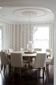 dining table that seats 10: beige dining room with round dining table seats