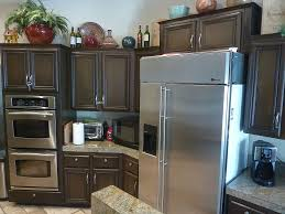 ge monogram refrigerator with brown wooden cabinet and lighting lamp for modern kitchen ideas cabinet and lighting