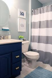 bathroom refresh: inexpensive bathroom refresh paint artwork accessories hardware shower curtain