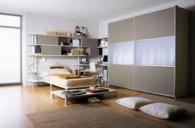 ravishing college apartment decor ideas with white laminated bed frame and study table plus wall storage carpets bedrooms ravishing home