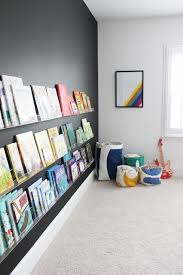 kids room decor with black wall and book shelves bonus room playroom office