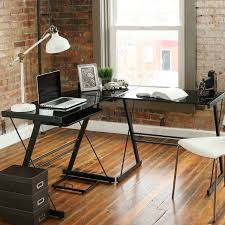 well integrated l shaped corner computer desk with x legs and glossy black glass top black glass top corner