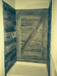 ideas shower systems pinterest: this shower was newly tiled with a new plank tile that has a weathered barnwood look