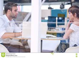 mentor busy tutoring his female student in co work space stock mentor busy tutoring his female student in co work space