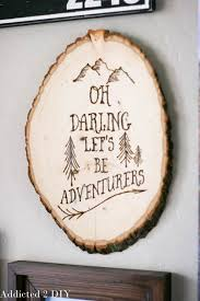 this wood burned wall art is gorgeous its perfect for a gallery wall or as artistic wood pieces design
