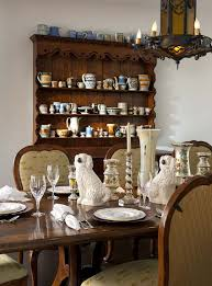 rustic hutch dining room: view in gallery spanish colonial dining room with a beautiful hutch and lovely lighting design astleford interiors