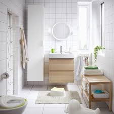 a medium size white bathroom with wall cabinets in white and white stained oak effect bathroomikea office furniture beautiful images