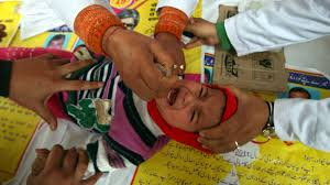 why it s worth spending a billion dollars a year to eradicate a child receives polio drops during a polio eradication programme in jammu 19 2012