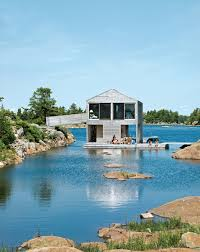 Timber Houses   Modern House Designs   Page Floating House   an Integrated Boathouse and Dock