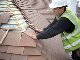 roof repair place: virginia based roofing repair contractors in action on top of roof