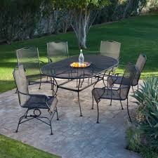 patio table and 6 chairs:  exterior transparent black high back with black framed ornament on curved legs for iron patio