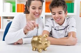 Responsible <b>Brother</b> And <b>Sister</b> Putting Money Into <b>Piggy</b> Bank ...