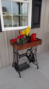 table i made from singer sewing machine base and an old crate old crates