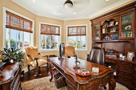 sligh furniture home office traditional with area rug basket storage brown carved wood dark stained wood blue home office dark wood