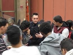 local boys and girls club discuss police interactions news lieutenant greg wozniak the jamestown police department talks to teen members of the winifred crawford