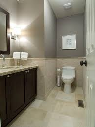 bathroom shower tile design color combinations: cool tiles for bathrooms with beige tile mosaic accent also dark brown vanity color with granite sink top also modern wall lamp and mirror design with brown