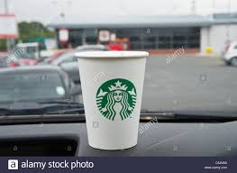 starbucks logo stock photos starbucks logo stock images alamy starbucks coffee to go in a takeaway paper cup new logo on a car dashboard