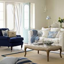 country living room ci allure: decorating with colours photo living room with white sofa and blue armchair country homes and interiors housetohomecouk