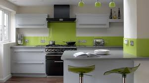 contemporary small kitchen design featuring white finish wooden kitchen cabinets and light green backsplash cabinet and lighting