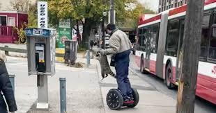 Man on segway rescuing <b>raccoon</b> from traffic is the hero Toronto ...