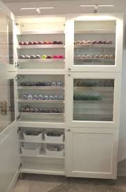 glass doors and lighting make this ikea besta cabinet a great place to organize and showcase anew office ikea storage