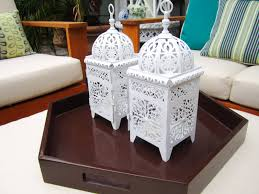 pottery barn style dining table: my hollywood hills deck makeover part the resource list two white metal moroccan style lantern centerpieces