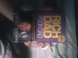 book review rich dad poor dad by robert t kiyosaki