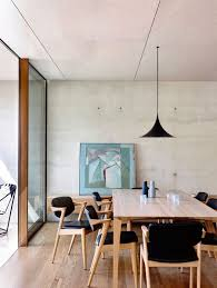 view in gallery dining room with a hint of black and concrete walls aussie lighting world