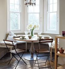 i love the simplicity of this breakfast table and its banquette style seating simple folding chairs and an unique pendant light complete the scene breakfast table lighting
