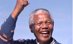 If we're to act to prevent climate change, more people need to learn lessons from Nelson Mandela and question the status quo. Photograph: Rex Features - Nelson-Mandela-010
