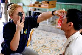 u s department of defense photo essay u s navy lt ann tarter left conducts a visual eye examination on a