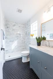 bathroom white tiles: girls bathroom shower and countertop carrara marble tile shower surround black hex tile gray vanity with carrara marble top wide spread faucet white oak