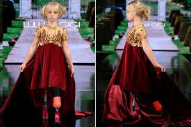 New York <b>Fashion</b> Week: 9-year-old <b>double</b> amputee struts catwalk