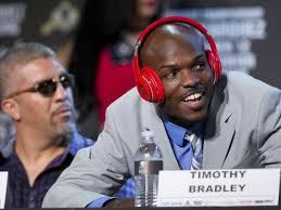 ... to music on his headphones during the final news conference Wednesday for his fight against Juan Manuel Marquez on Saturday. (Photo: Julie Jacobson, AP) - 1381365146000-AP-Bradley-Marquez-Boxing