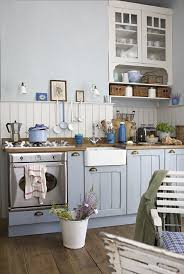 coastal kitchen with light blue cabinets and rustic flare blue cabinet kitchen lighting